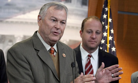 Rep. Dana Rohrabacher, R-Calif., left, accompanied by Rep. Jared Polis, D-Colo., speaks during a news conference on Capitol Hill in Washington, Thursday, Nov, 13, 2014, to discuss marijuana laws.