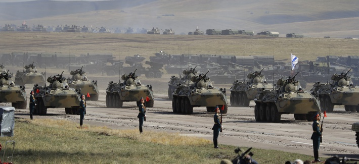 """Russian marines ride armored vehicles during a military exercises on training ground """"Tsugol"""", about 250 kilometers (156 miles ) south-east of the city of Chita during the military exercises Vostok 2018 in Eastern Siberia, Russia, Thursday, Sept. 13, 2018"""