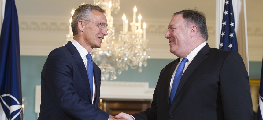 Secretary of State Mike Pompeo, right, shakes hands as he meets with NATO Secretary General Jens Stoltenberg at the State Department in Washington, Thursday, Sept. 13, 2018.