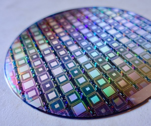 A wafer full of D-Wave's latest quantum processors as shown at the Age of AI conference in February 2018.