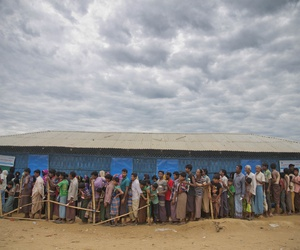 Rohingya Muslims, who crossed over from Myanmar into Bangladesh, wait in queues to receive aid at Kutupalong refugee camp in Ukhiya, Bangladesh, Wednesday, Nov. 15, 2017.