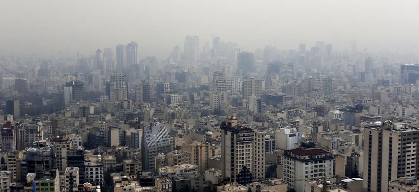 Air pollution blankets the skyline in Tehran, Iran, Sunday, Dec. 20, 2015.