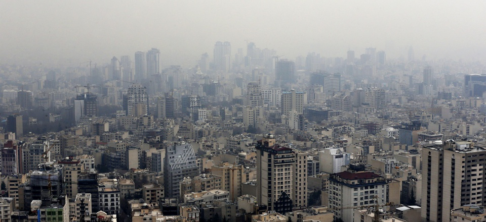 Air pollution blankets the skyline in Tehran, Iran, Sunday, Dec. 20, 2015.