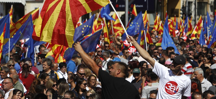 """People waving Macedonian and EU flags take part in a march named """"For European Macedonia"""", through a street in Skopje, Macedonia, Sunday, Sept. 16, 2018."""