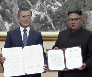 In this image made from video, South Korean President Moon Jae-in, left, and North Korean leader Kim Jong Un pose after signing documents in Pyongyang, North Korea Wednesday, Sept. 19, 2018.