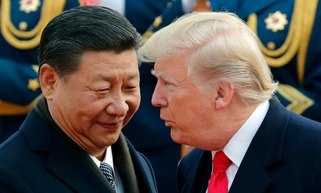 In this Nov. 9, 2017, file photo, U.S. President Donald Trump, right, chats with Chinese President Xi Jinping during a welcome ceremony at the Great Hall of the People in Beijing.