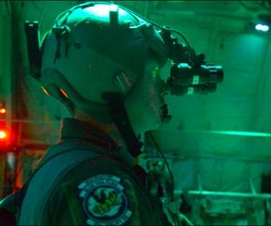 A U.S. Air Force loadmaster uses night vision goggles during a night flight over Bulgaria, July 15, 2018.
