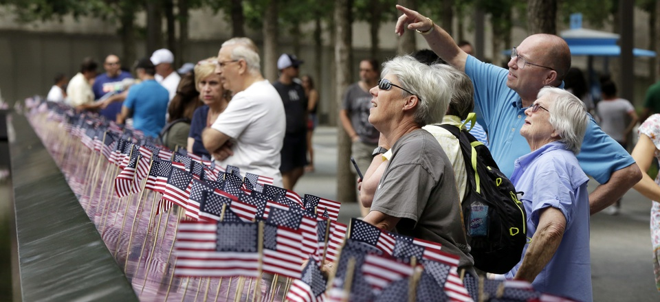 American flags were inserted in each of the 2.983 names on the borders of the reflecting pools of the 9/11 Memorial, in New York, Tuesday, July 4, 2017.