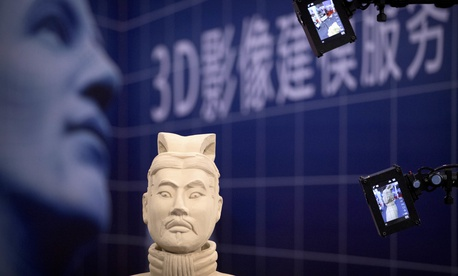 Video cameras scan a replica of a terra-cotta warrior figure at the 21st China Beijing International High-tech Expo in Beijing, China, Friday, May 18, 2018. The annual expo is a showcase of China's state-of-the-art technologies and cutting-edge ideas.