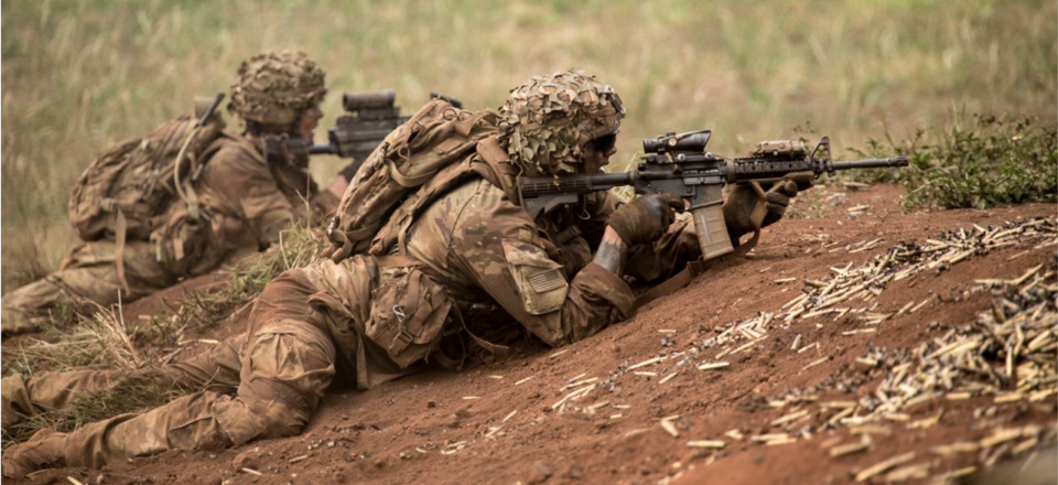 """U.S. Army Soldiers assigned to 1st Battalion, 21st Infantry Regiment """"Gimlets"""", 2nd Infantry Brigade Combat Team, 25th Infantry Division, provide protective fire support during a combined arms live-fire exercise at Schofield Barracks, August 9, 2018."""