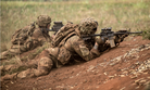 "U.S. Army Soldiers assigned to 1st Battalion, 21st Infantry Regiment ""Gimlets"", 2nd Infantry Brigade Combat Team, 25th Infantry Division, provide protective fire support during a combined arms live-fire exercise at Schofield Barracks, August 9, 2018."