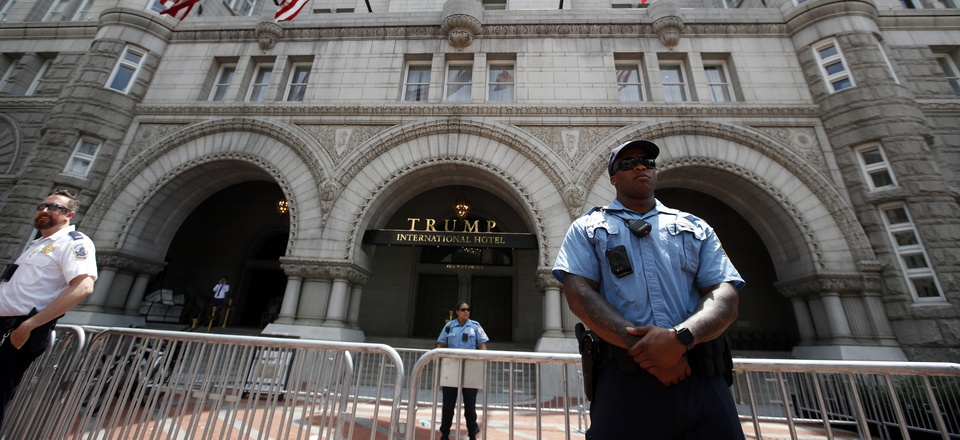 Law enforcement officers stand guard in front of the Trump Hotel during a march to protest the Trump administration's approach to illegal border crossings and separation of children from immigrant parents, Saturday, June 30, 2018, in Washington.