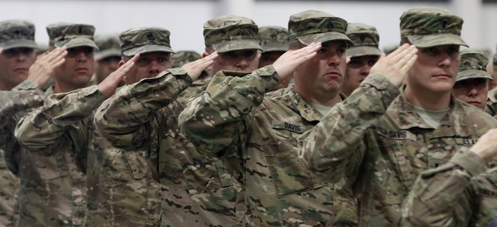 Soldiers from 2nd Battalion, 162nd Infantry Regiment, Oregon Army National Guard, render a salute during the National Anthem at their demobilization ceremony in Albany, Oregon, June 13, 2017.