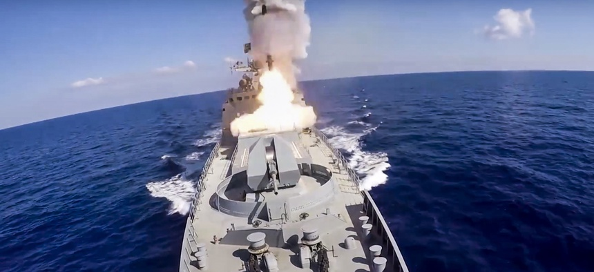 In this image provided by Russian Defense Ministry Press Service and released on Friday, June 23, 2017, long-range Kalibr cruise missiles are launched by a Russian Navy ship in the eastern Mediterranean.