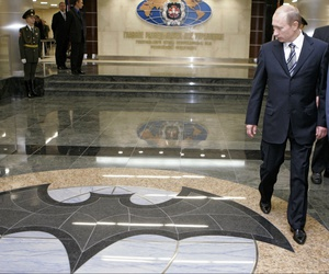 n this Wednesday, Nov. 8, 2006 file photo, Russian President Vladimir Putin, right, walks through a hall in the building of the Main Directorate of the General Staff of the Armed Forces of Russia, also know as Russian intel service in Moscow.