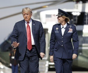 President Donald Trump arrives to board Air Force One for a trip to Minnesota to attend a fundraiser, and a campaign rally, Oct. 4, 2018, in Andrews Air Force Base, Md.