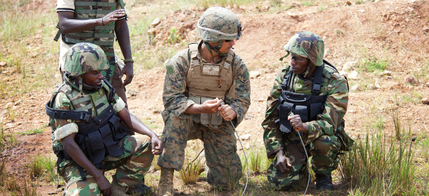 A U.S. Marine from the Special-Purpose Marine Air-Ground Task Force Africa demonstrates combat engineer skills for Burundi National Defense Forces personnel.