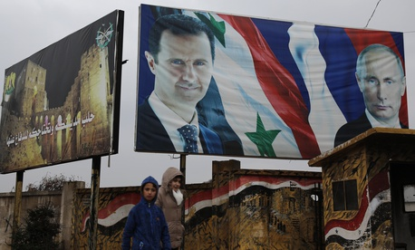 yrian walk by posters of Syrian President Bashar Assad and Russian President Vladimir Putin in Aleppo, Syria, Thursday, Jan. 18, 2018.