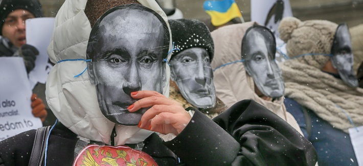 Colleagues of jailed journalist Roman Sushchenko wear masks depicting Russian President Vladimir Putin during a protest in front of the Russian Embassy demanding his release in Kiev, Ukraine, Wednesday, Nov. 2, 2016.
