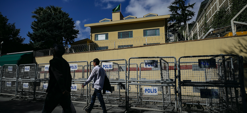 People walk past the the Saudi Arabian consulate in Istanbul, Sunday, Oct. 7, 2018.
