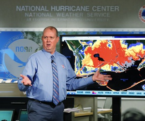 National Hurricane Center director Ken Graham, gestures as he talks about storm surge during a televised update on the status of Hurricane Michael, Tuesday, Oct. 9, 2018, at the Hurricane Center in Miami.