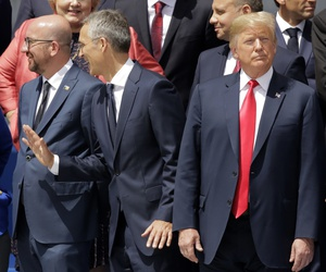 German Chancellor Angela Merkel, Belgian Prime Minister Charles Michel, NATO Secretary-General Jens Stoltenberg and U.S. President Donald Trump, from left, watch a fly-by during a summit of heads of state and government in Brussels July 11, 2018.