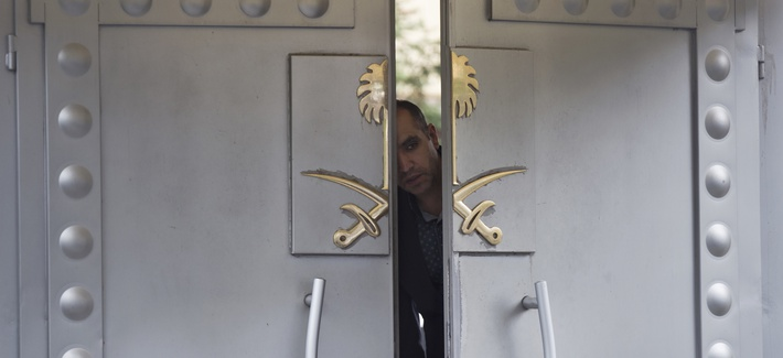 A security personnel looks out from the entrance of the Saudi Arabia's consulate in Istanbul, Sunday, Oct. 14, 2018.