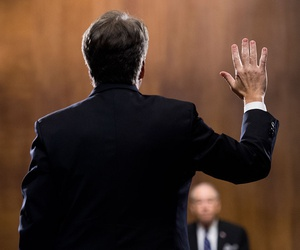Brett Kavanaugh is sworn in by Chairman Chuck Grassley, R-Iowa, before testifying on Sept. 27.