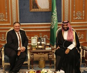 U.S. Secretary of State Mike Pompeo meets with the Saudi Crown Prince Mohammed bin Salman under a portrait of Saudi King Salman, in Riyadh, Saudi Arabia, Tuesday Oct. 16, 2018.
