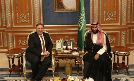 U.S. Secretary of State Mike Pompeo meets with the Saudi Crown Prince Mohammed bin Salman under a portrait of Saudi King Salman, in Riyadh, Saudi Arabia, Tuesday Oct. 16, 2018.