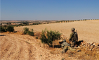 U.S. Soldiers provide security during an independent, coordinated patrol outside Manbij, Syria, August 19, 2018.