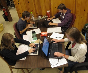 Students enter information from Adirondack hiking trail registers into a computer map program at the State University of New York College of Environmental Science and Forestry research station in Newcomb, NY, on June 12, 2013.