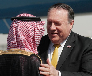 Mike Pompeo, right, greets Saudi Foreign Minister Adel al-Jubeir, after arriving in Riyadh on Tuesday.
