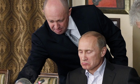 - In this Friday, Nov. 11, 2011, file photo, Yevgeny Prigozhin, left, serves food to Russian Prime Minister Vladimir Putin during dinner at Prigozhin's restaurant outside Moscow, Russia.