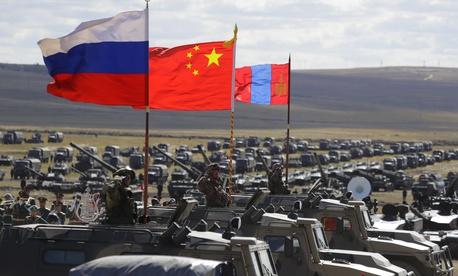 "Russian, Chinese and Mongolian national flags set on armored vehicles develop in the wind during a military exercises on training ground ""Tsugol"", during the military exercises Vostok 2018 in Eastern Siberia, Russia, Sept. 13, 2018."