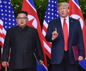 In this June 12, 2018, file photo, U.S. President Donald Trump makes a statement before saying goodbye to North Korea leader Kim Jong Un after their meetings at the Capella resort on Sentosa Island in Singapore.