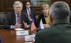 U.S. National Security Adviser John Bolton, left, gestures while speaking to Russian Defense Minister Sergei Shoigu, back to a camera, during their meeting in Moscow, Russia, Tuesday, Oct. 23, 2018.