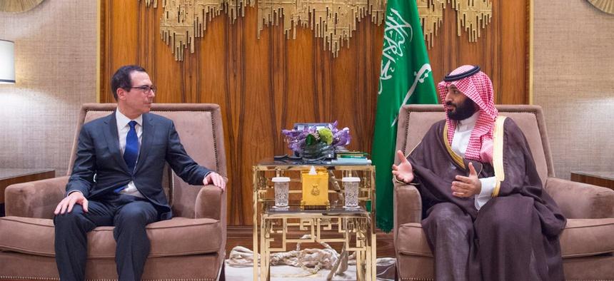In this Monday, Oct. 22, 2018 photo released by Saudi Press Agency, SPA, Saudi Crown Prince, Mohammed bin Salman, right, talks with the U.S. Secretary of the Treasury Steven Mnuchin in Riyadh, Saudi Arabia.