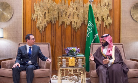 In this Monday, Oct. 22, 2018 photo released by Saudi Press Agency, SPA, Saudi Crown Prince, Mohammed bin Salman, right, talks with the U.S. Secretary of the Treasury Steven Mnuchin in Riyadh, Saudi Arabia.