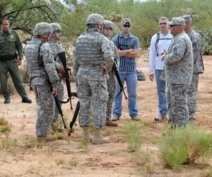 Border Patrol agents observe Arizona National Guard Soldiers training in Arizona in 2010.