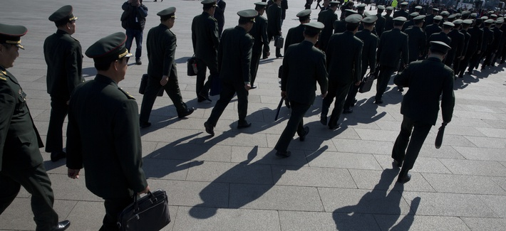 In this photo taken Wednesday, March 8, 2017, Chinese military officers file into near the Great Hall of the People where a plenary session of the National People's Congress is held in Beijing, China.