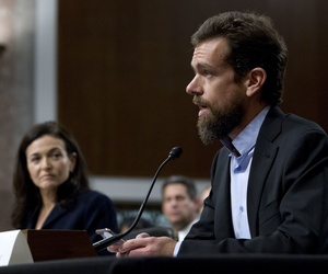 Twitter CEO Jack Dorsey, accompanied by Facebook COO Sheryl Sandberg, testify before the Senate Intelligence Committee hearing on 'Foreign Influence Operations and Their Use of Social Media Platforms' on Capitol Hill, Wednesday, Sept. 5, 2018, in DC.