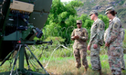Sgt. Patricia Donaldson, a military systems maintainer/integrator assigned to 715th Military Intelligence Battalion, briefs colleagues on communications equipment during training exercise Lightning Forge on the Island of Oahu July 24, 2018.