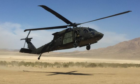 U.S. Army Soldiers assigned to Company C, 3rd Battalion, 501st Aviation Regiment, Combat Aviation Brigade, 1st Armored Division, land a UH-60M Black Hawk helicopter at the National Training Center, Fort Irwin, Calif.