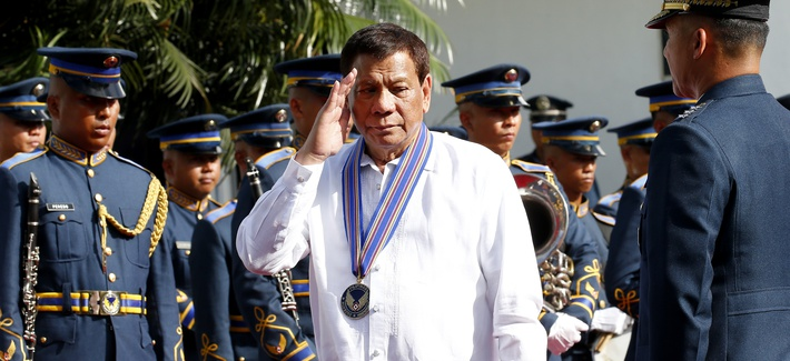Philippine President Rodrigo Duterte salutes during a wreath-laying ceremony at the 71st Founding Anniversary of the Philippine Air Force at Villamor Air Base in suburban Pasay city south of Manila, Philippines Tuesday, July 3, 2018.