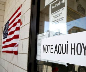 A sign announces a polling place in Spanish outside of the Harrison Community Center during New Jersey's primary election in June in Harrison, N.J.