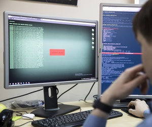 An employee of Global Cyber Security Company Group-IB develops a computer code in an office in Moscow, Russia, Wednesday, Oct. 25, 2017.