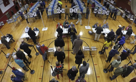 Voters wait in line in the gymnasium at Brunswick Junior High School to receive their ballots for the mid-term election, Tuesday, Nov. 6, 2018, in Brunswick, Maine.
