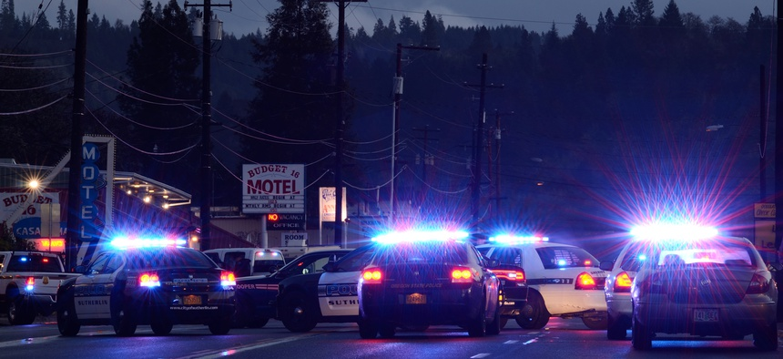 Police cars at incident where a person who shot at officers and then barricaded himself in a hotel in Roseburg Oregon, December 17, 2012.