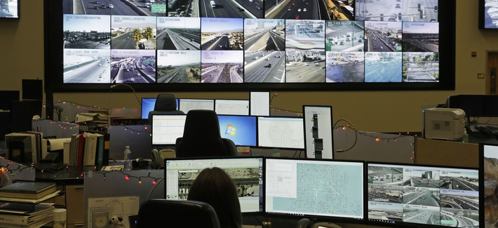 Screens show the feeds from traffic cameras at the Regional Transportation Commission of Southern Nevada's FAST traffic management center, Tuesday, Dec. 6, 2016, in Las Vegas.
